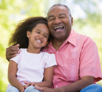 Photo of a man and child laughing. Link to Life Stage Gift Planner.